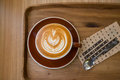 Coffee latte art on the wood tray in shop Stock Images