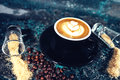 Coffee latte in coffee shop. Close-up of latte art Royalty Free Stock Photo