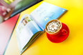 Coffee latte with flower art and book on yellow table Stock Image