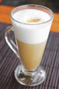 Coffee latte with frothy milk in tall glass cup of on table cappuccino Stock Photography