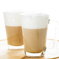 Coffee latte in glass mugs on the board Stock Photography