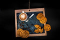 Coffee latte with heart and oatcakes top view on chalkboard Royalty Free Stock Photo