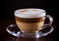 Coffee latte macchiato on a black background Royalty Free Stock Photo