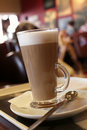Coffee latte in a tall glass, Cafe background Royalty Free Stock Image