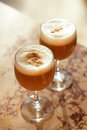 Coffee latte in tall glasses with morning sun in summer cafe bac Royalty Free Stock Photo
