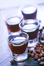 Coffee liquor into small glasses and on a table Royalty Free Stock Photography