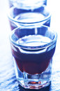 Coffee liquor into small glasses and on a table Royalty Free Stock Photos