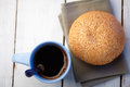 Coffee and loaf with sesame Stock Image