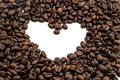 Coffee lover with fresh bean shaped into heart in white background with clipping path Stock Photo