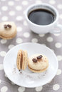 Coffee macarons with a cup of coffee on grey polka dot background Stock Photo