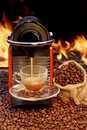 Coffee machine with cup of espresso near fireplace capsule and xxxl Stock Photo