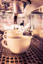 Coffee machine making espresso in a cafe. Royalty Free Stock Photo