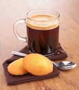 Coffee and madeleine on wood Royalty Free Stock Photos