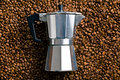 Coffee maker on coffee beans top view of Royalty Free Stock Image