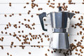 Coffee maker with coffee beans top view of on white wooden background Stock Photo
