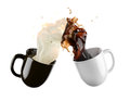 Coffee and milk flying cups of Royalty Free Stock Image