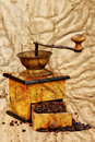 Coffee mill and beans in grunge style Royalty Free Stock Image