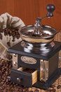 Coffee mill with burlap sack of roasted beans Stock Photos