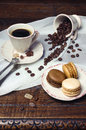 Coffee mood: cup of coffee, coffee beans and multicolored macaroons Royalty Free Stock Photo