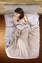 Coffee in the morning top view young caucasian woman having bed Stock Images