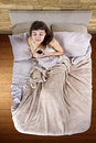 Coffee in the morning top view young caucasian woman having bed Royalty Free Stock Images