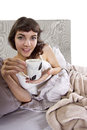 Coffee in the morning young caucasian woman having bed Stock Image
