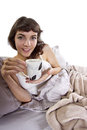 Coffee in the morning young caucasian woman having bed Stock Photos