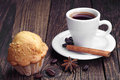 Coffee and muffin cup of on vintage wooden table Stock Images