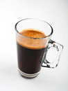 Coffee mug espresso in glass Royalty Free Stock Image