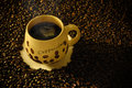 Coffee mug a full of fresh displayed on vast bean background Royalty Free Stock Images