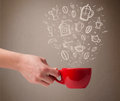 Coffee mug with hand drawn kitchen accessories close up Stock Image