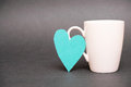 Coffee mug love real cut out of paper heart leaning on a for your romantic addiction or effects of drinking on the heart Stock Images