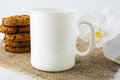 Coffee mug mockup with cookies Royalty Free Stock Photo