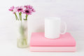 Coffee mug mockup with lilac daisy Royalty Free Stock Photo