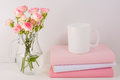 Coffee mug mockup with pink roses Royalty Free Stock Photo