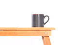 Coffee mug and table on a white background Stock Photo