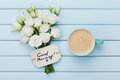 Coffee mug with white flowers and notes good morning on blue rustic table from above. Beautiful breakfast. Flat lay. Royalty Free Stock Photo