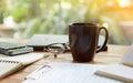 Coffee mug on wooden desk