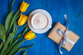 Coffee mug with yellow tulip flowers and gift Royalty Free Stock Photo