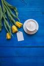 Coffee mug with yellow tulip flowers Royalty Free Stock Photo