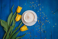 Coffee mug with yellow tulip flowers Royalty Free Stock Photo