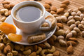 Coffee with nuts, fig and dried apricots Royalty Free Stock Photos