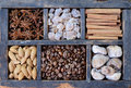 Coffee nuts and spices in rusted wooden box mix of beans almond brown sugar figs old Royalty Free Stock Photos