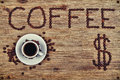 Coffee offer beans cup and dollar symbol on wooden table Royalty Free Stock Images