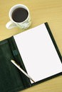 Coffee open notebook and pen on wooden table Royalty Free Stock Photography