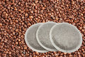 Coffee pads over coffee beans Royalty Free Stock Image