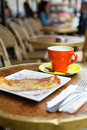 Coffee and pancake in a parisian cafe street Stock Image