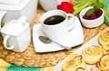 Coffee pastries and berries a cup of with a bowl of red raspberries Royalty Free Stock Photo