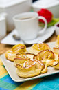 Coffee and pastries on a table Stock Photography
