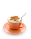 Coffee in a peach cup Royalty Free Stock Image